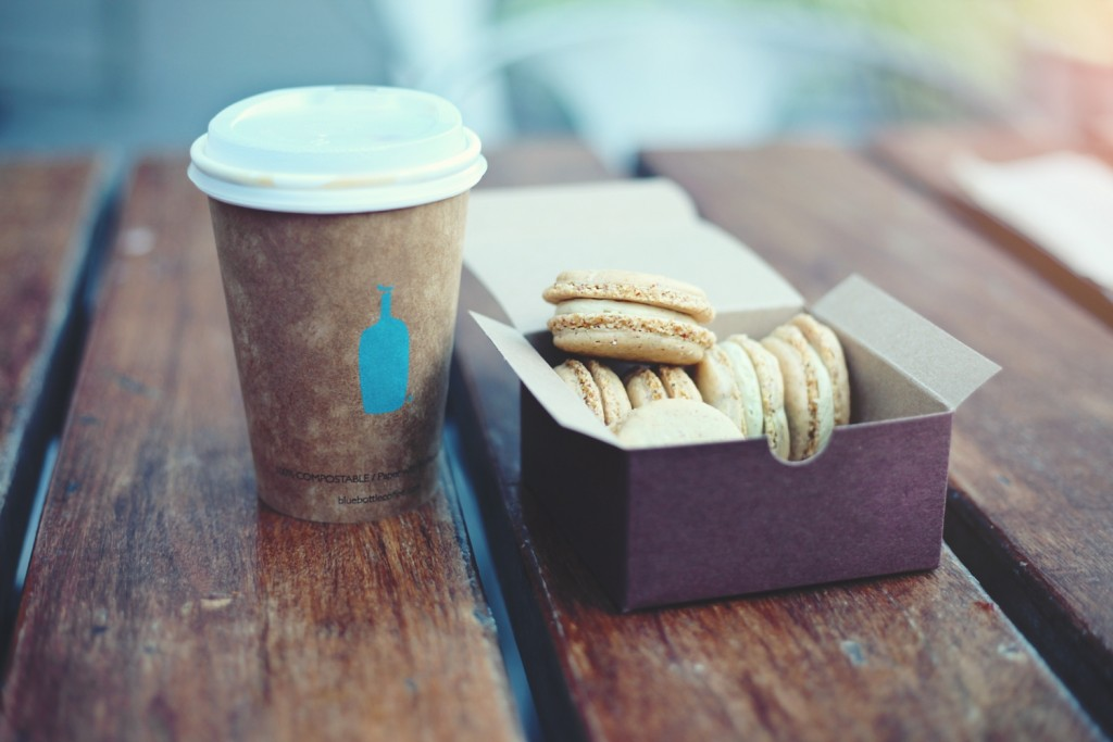 Image of a disposable coffee cup and macaroon box
