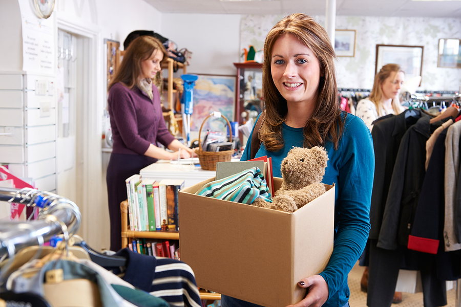 woman donating items to a charity shop