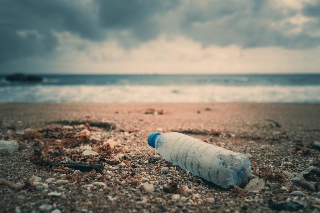 plastic bottle litter on a beach
