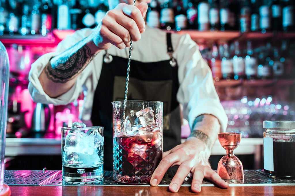 barman using recycled glass to make drinks