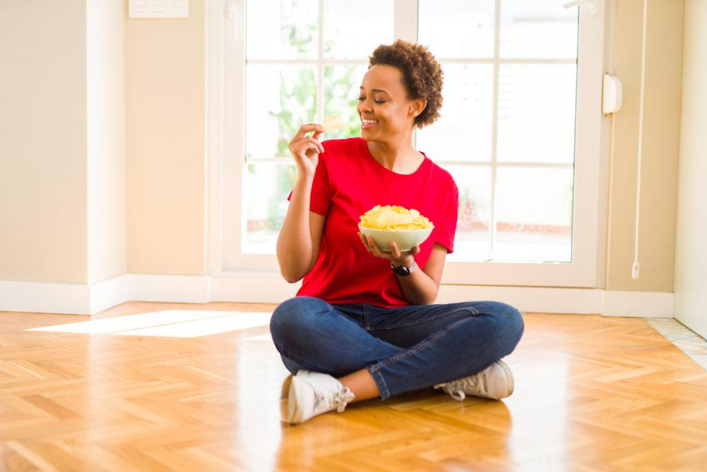 woman eating crisps
