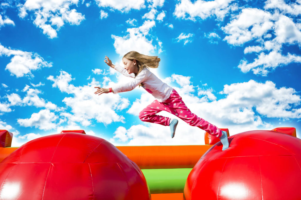 child playing on bouncy castle