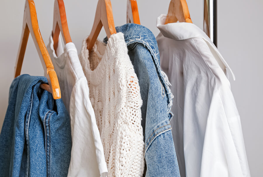 clothes hanging on rail for capsule wardrobe