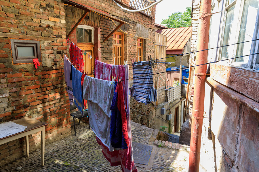 clothes hanging on a washing line outside a house