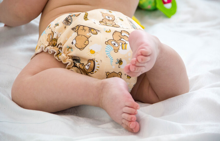 Baby wearing a reusable cloth nappy which is eco-friendly