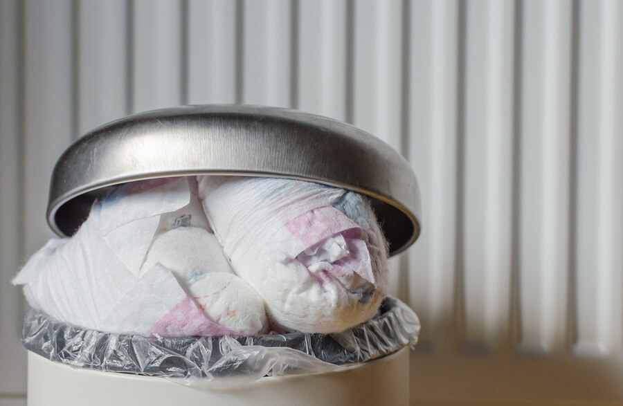 a bin overflowing with disposable nappies