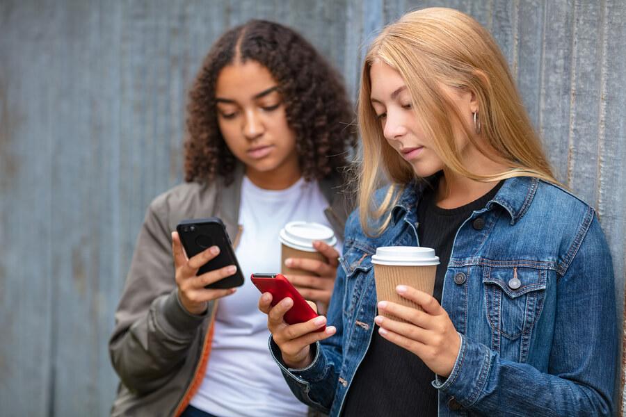 friends holding takeaway coffee cups