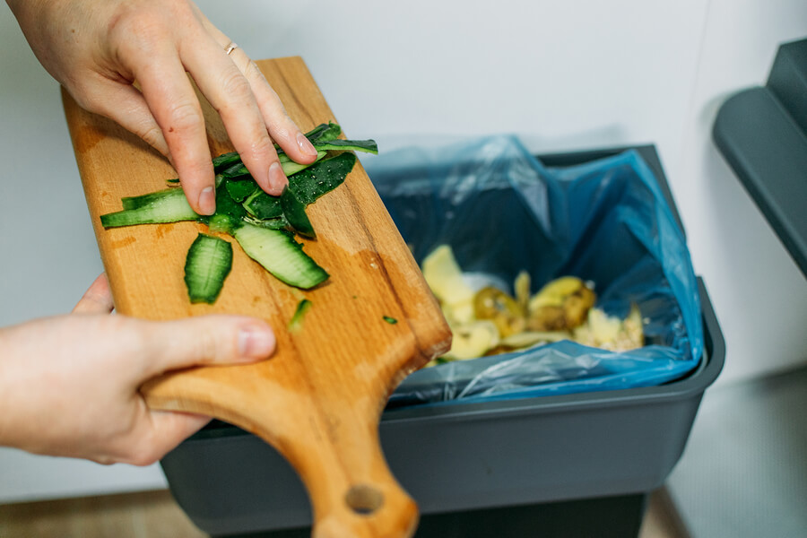 food waste being put in the compost bin