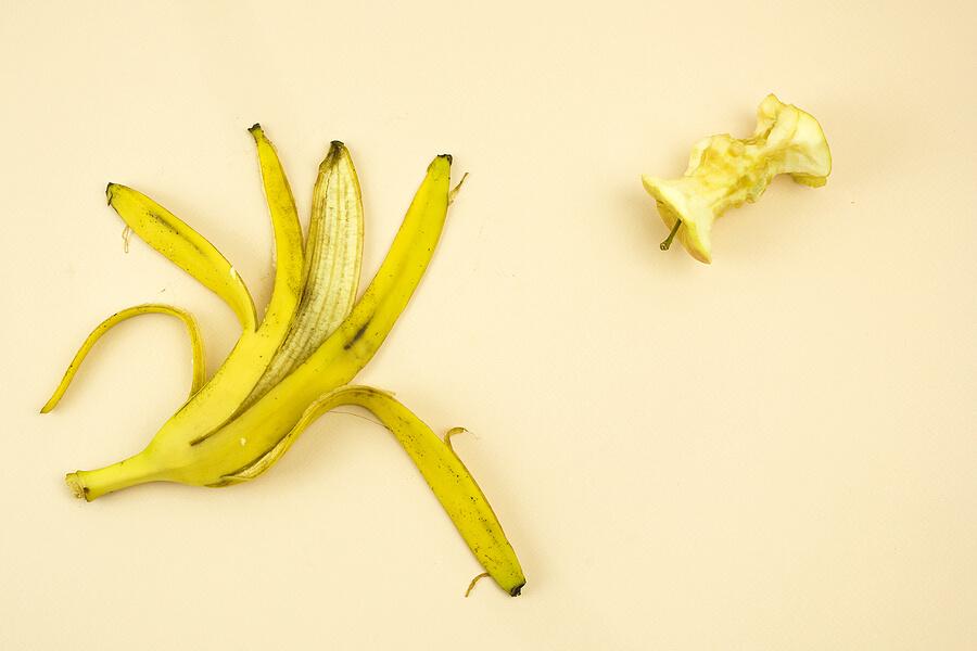 Banana skin and an eaten apple.