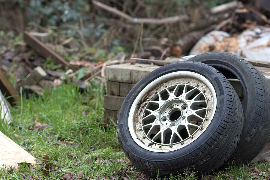 Two fly-tipped car tyres