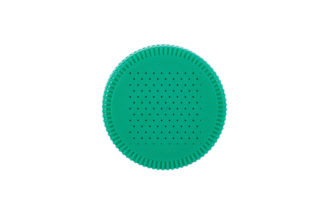 A green plastic bottle top with holes in it, on a white background