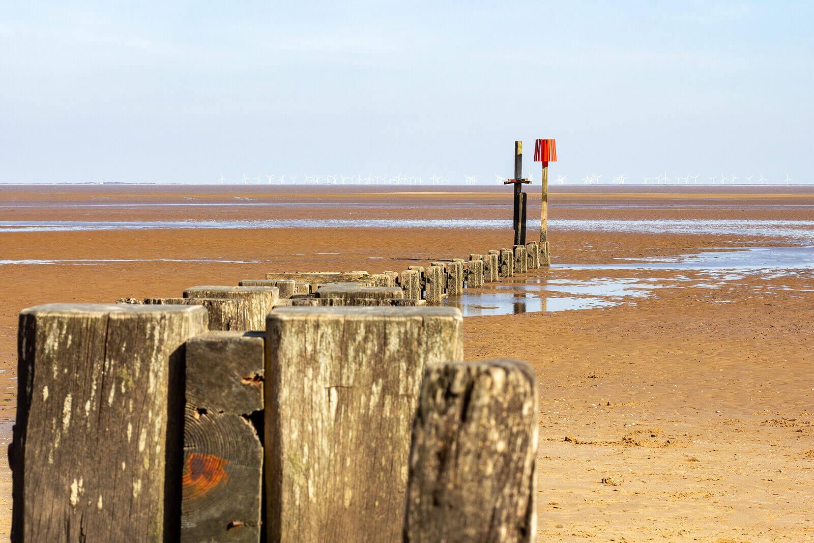 Wooden groynes on Cleethorpes sandy beach